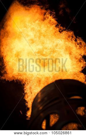 Flames in the night to heat up a hot air balloon.