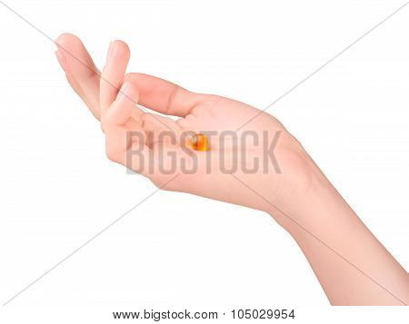 Female Hand With Orange Pill