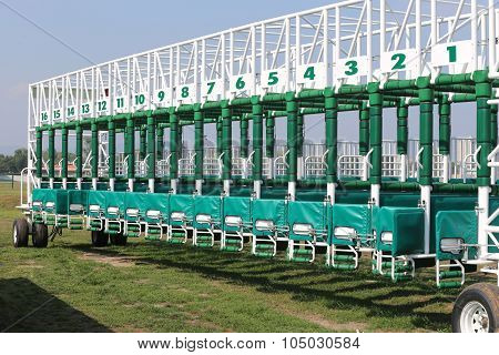 Horse Track With Starting Gates At A Race Track Summertime