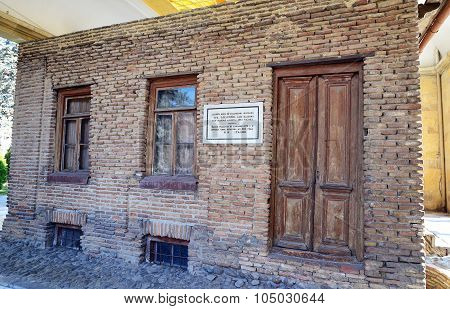 Gori, Georgia - March 4, 2015: House-museum Of Joseph Stalin With Memorial Plaque In His Native Town