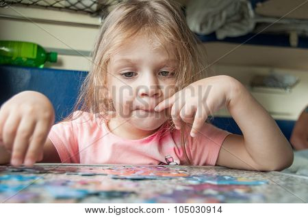 Girl Collects Puzzles While On A Train