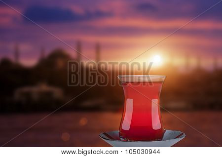 Turkish tea and Istanbul silhouette during sunset