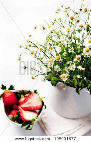 Bunch of camomile flowers with strawberry