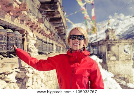 Happy Woman Hiker And Prayer Wheel In Nepal
