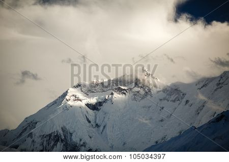 Mountain inspirational landscape in Himalayas Annapurna range Nepal. Mountain ridge with ice and sno