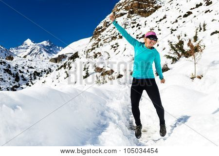 Woman happy success running and jumping on white snow in Hi