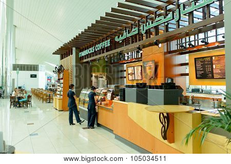 DUBAI - APRIL 18, 2014: Starbucks cafe. Starbucks locations serve hot and cold beverages, whole-bean coffee, microground instant coffee, espresso, caffe latte, full-leaf teas, pastries, and snacks