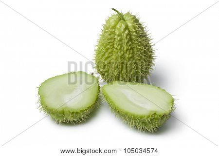 Whole and half spined fresh chayote fruit on white background