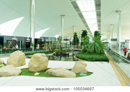 DUBAI, UAE - APRIL 18, 2014: Dubai international Airport interior. Dubai Airport is the primary airport serving Dubai and is the world's busiest airport by international passenger traffic