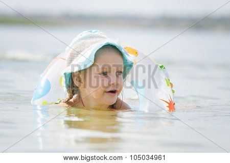 Four-year Girl With A Circle Floating In The River