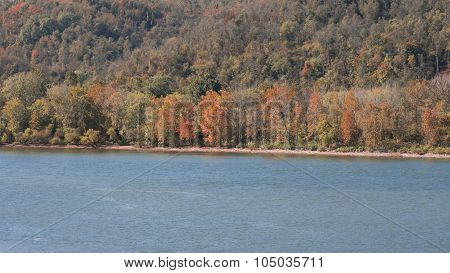 River Shoreline with Autumn or Fall Tree Foliage.