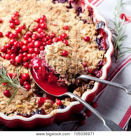 Cranberry, bilberry crumble with rosemary