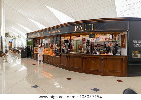 DUBAI, UAE - APRIL 18, 2014: Paul cafe in the airport. Paul menu products include pastries, cakes, croissants, sandwiches, soups, quiches, tarts, crepes, eggs, and over many types of bread.