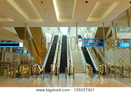 DUBAI - APRIL 18, 2014: Dubai international Airport interior. Dubai International Airport is the primary airport serving Dubai, and is the world's busiest airport by international passenger traffic.
