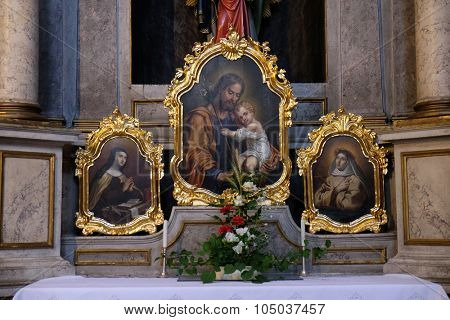 LJUBLJANA, SLOVENIA - JUNE 30: Saint Joseph holding child Jesus, painting on the altar in the St Nicholas Cathedral in Ljubljana, Slovenia on June 30, 2015