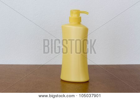 Yellow Bottles Of Health And Beauty Products Cosmetic On The Wood