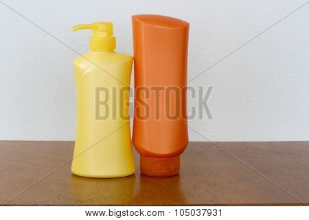 Group Of Bottles Of Health And Beauty Products Cosmetic On The Wood