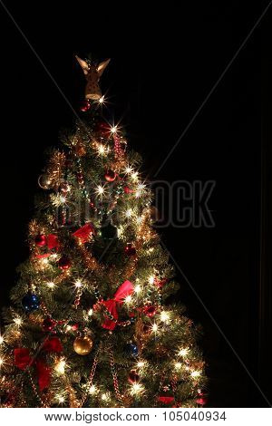 Decorated Christmas tree on black background