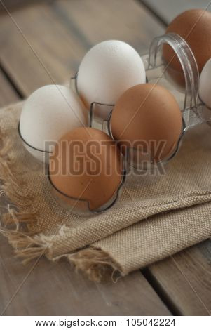 Chicken eggs on textured mat