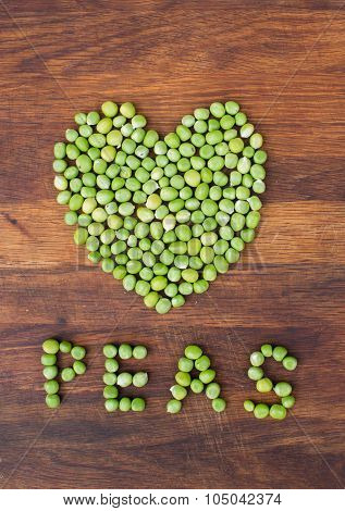 Heart Made Of Fresh Locally Grown Green Peas On Wooden Background