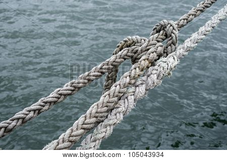 Old Ship Ropes Tightened Closeup