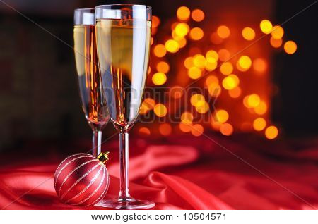 Two Champagne Glasses On Red Silk