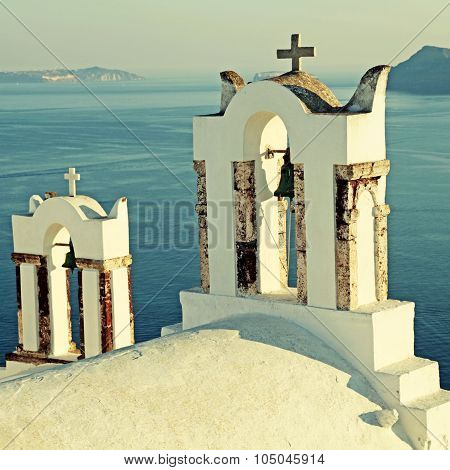 Bell Tower Of Old White Church Above The Beautiful Blue Sea, Oia, Santorini