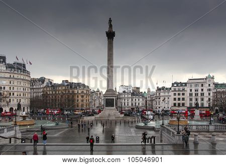 Trafalgar Square, London on a rainy, gray day.