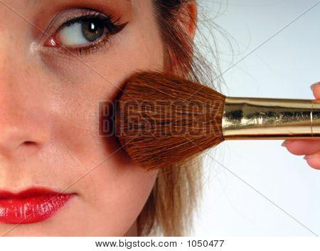 Woman Putting On Blusher