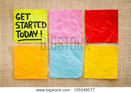 Get started today reminder - handwriting on a sticky note against burlap canvas with blank notes