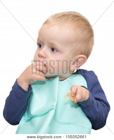 The Thoughtful Kid With A Piece Of Bread In The Left Hand And Fingers Of The Right Hand In A Mouth