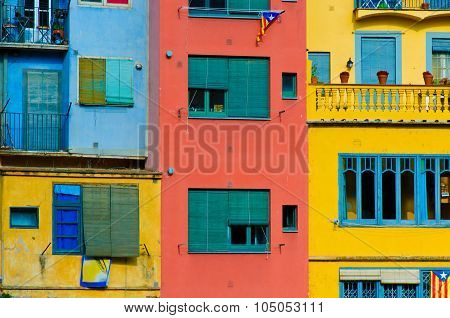 Close Up Of Colorful Old Houses And Windows. Girona, Spain. Color Blocks Architecture Background