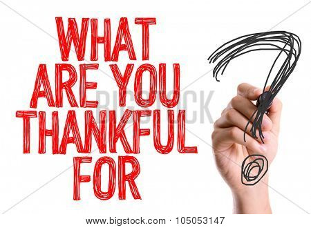 Hand with marker writing: What Are You Thankful For?