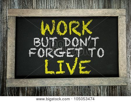 Work But Don't Forget to Live written on chalkboard
