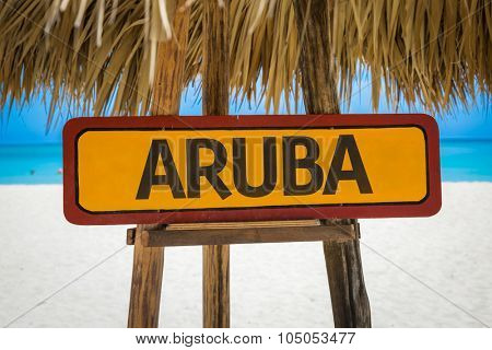 Aruba sign with beach background