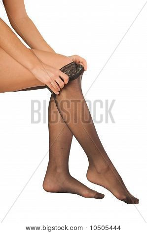 Women`s Hands Wearing On Pantyhose