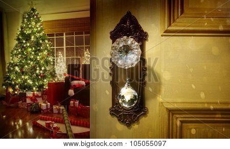 Open door with decorated Christmas tree in room