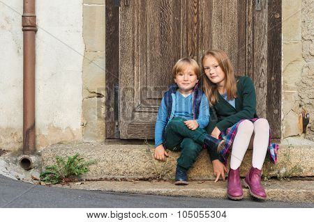 Outdoor portrait of two adorable kids