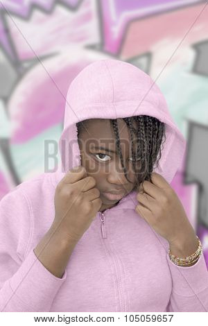 Rebel preteen wearing a pink hooded sweatshirt