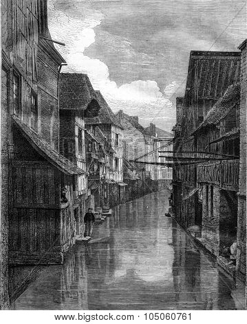 Pont-Audemer, View from the Commerce Street bridge in Grand Moulin, vintage engraved illustration. Magasin Pittoresque 1878.