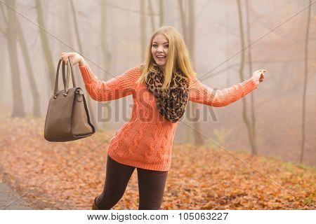 Carefree Fashion Woman Relaxing In Autumn Park.