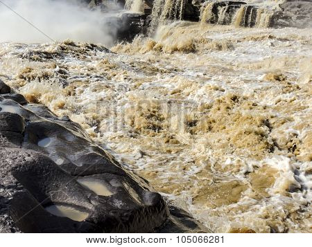 the choppy waters of the Yellow river with eroded rocks
