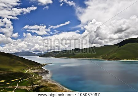 YamdrokTso Lake of Tibet with mountains and blue sky