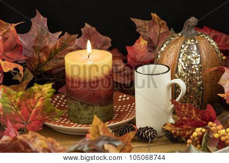Coffee, Lit Candle And Pumpkin Decor