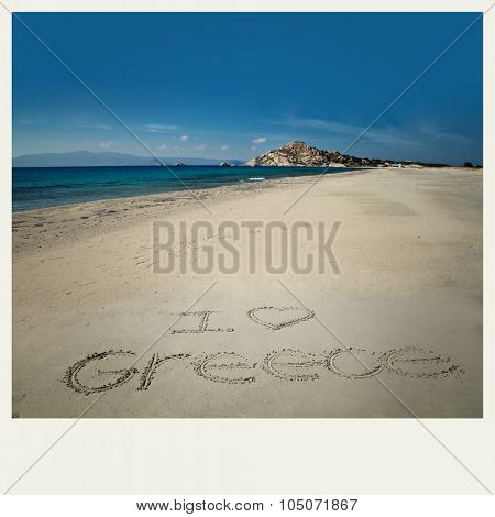 I love greece sign write in sand at Orkos beach in Naxos, Greece