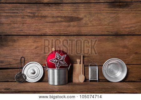 Old dark brown wooden background with christmas decoration and old dinnerware for cooking items.