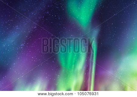 Aurora Borealis On A Starry Sky