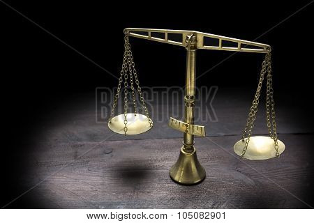Vintage Brass Scales Of Justice In Spotlight Against A Black Background