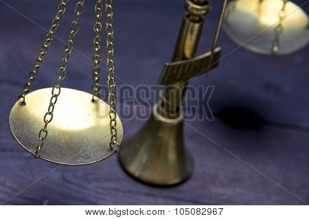Part Of Scale Or Scales Of Brass On A Dark Wood, Justice Concept