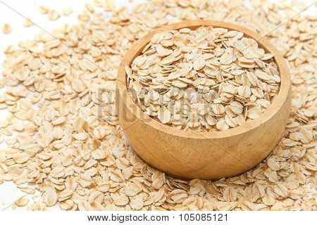 Closeup Oats In Bowl, On Oats Background.